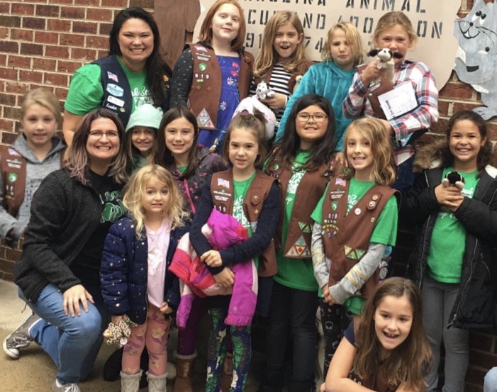 BROWNIES FROM TROOP 619 EARN THEIR UPSTANDER PATCH